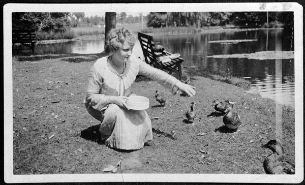 Elsie Stevens feeding ducks in Elizabeth Park.