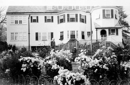 Wallace Stevens behind his Westerly Terrace home.